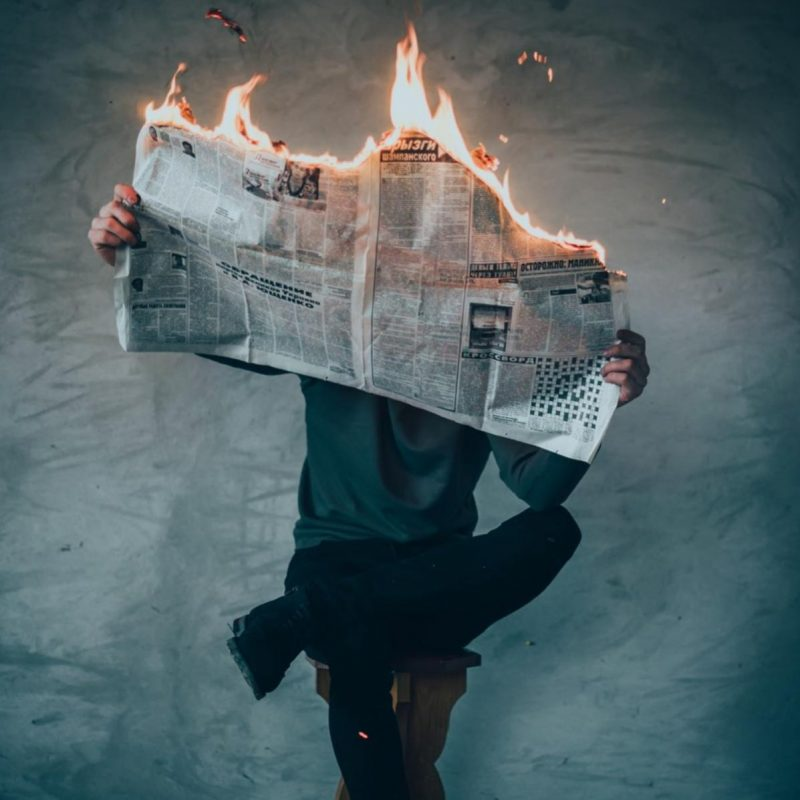 Flaming newspaper